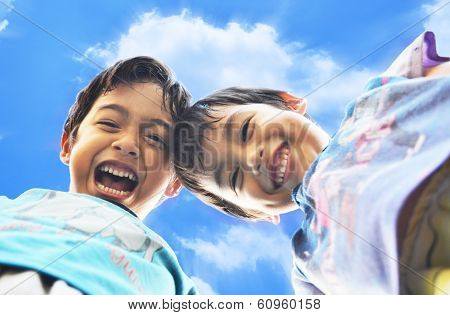 Little Boy Laughting With Blue Sky And Cloud