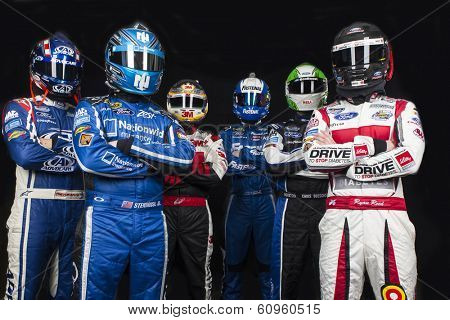 DAYTONA BEACH, NC - FEB 19, 2014:  Trevor Bayne, Ricky Stenhouse, Jr., Greg Biffle, Carl Edwards, Chris Boucher, Ryan Reed pose at the Daytona International Speedway in Daytona Beach, FL.