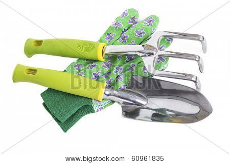 Garden gloves, trowel and hand rake on white.