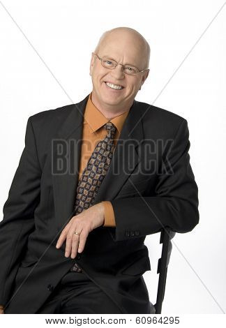 Waist-up photo of mature businessman on white background.