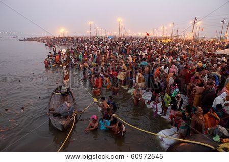 Allahabad, India - February 10, 2013: Hindu devotees came to confluence of the Ganges and the Yamuna River for holy dip during the festival Kumbh Mela. It is the world's largest religious gathering