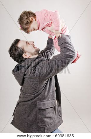 Father Lifting Baby