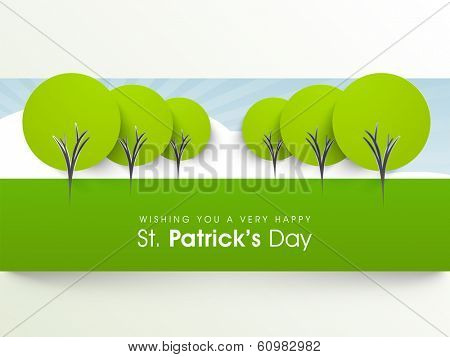 Happy St. Patrick's Day celebrations sticker, tag or label design with green trees on abstract background.