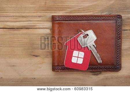 wallet and key on wood background