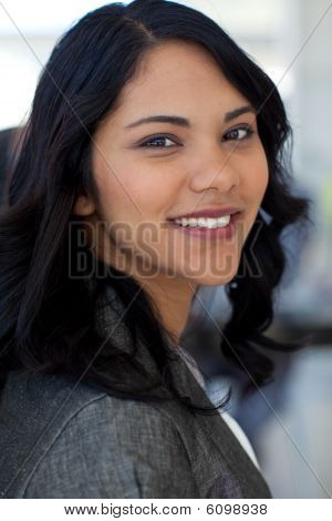 Portrait Of Friendly Businesswoman In Office Smiling At The Camera