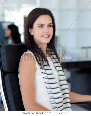Businesswoman Sitting In Her Workplace