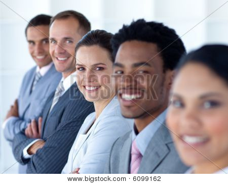 Beautiful Businesswoman With Her Team In A Line