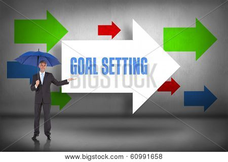 The word goal setting and peaceful businessman holding blue umbrella against arrows pointing