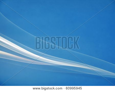 abstract smoke curves on blue background