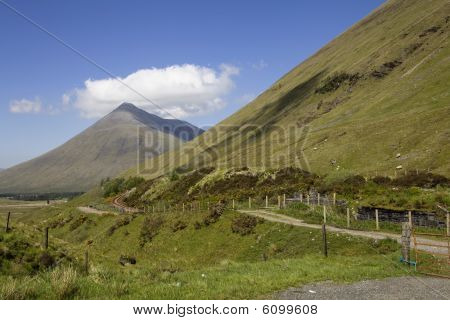 Mountain Beinn Dorain Scotland Highlands with a cloud over it