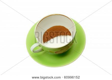 Powdered instant coffee and granulated sugar in a cup for drink preparation