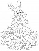 image of cony  - Little rabbit sitting on a pile of decorated Easter eggs - JPG