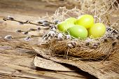 stock photo of wooden basket  - Easter basket with Easter Eggs on wooden background - JPG