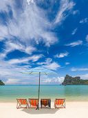 image of phi phi  - Sunbeds and umbrella at beautiful bay of Phi Phi island at day time - JPG