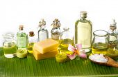 Health spa with massage oil and frangipani ,on banana leaf
