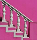 stock photo of balustrade  - Close up of white Precast Balustrades with pink house wall - JPG