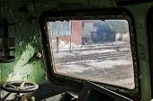 stock photo of railcar  - Part of control cabin of abandoned and crumbling railcar
