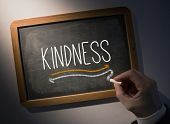 picture of kindness  - Hand writing the word kindness on black chalkboard - JPG