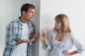 stock photo of conflict couple  - Unhappy couple having an argument at home - JPG