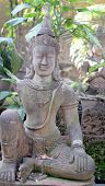 stock photo of gautama buddha  - an image of Buddha statue in the garden - JPG