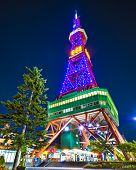 SAPPORO, JAPAN - OCTOBER 16, 2012: Sapporo Tower stands over Odori Park. The 147.2 meter high tower