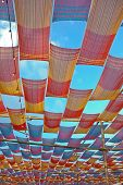 stock photo of canopy roof  - deco colorful fabric canopy roof outdoor on cloudy sky background