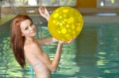 picture of poka dot  - sexy brunette woman playing in an indoor swimming pool - JPG