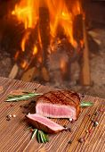 Beef Steak  On A Background Of Fire