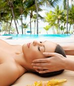 health, spa and beauty concept - calm beautiful woman in massage salon