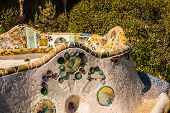 stock photo of gaudi barcelona  - Barcelona Park Guell of Gaudi tiles mosaic serpentine bench modernism - JPG
