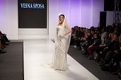 ZAGREB, CROATIA - FEBRUARY 15, 2014: Fashion model in wedding dress on 'Wedding fair' show