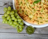 Focaccia with grapes and sauce Pesto close-up