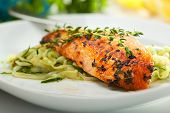 stock photo of zucchini  - Salmon Steak with Zucchini Noodles - JPG