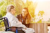 pic of grandmother  - Young woman is visiting her grandmother in nursing home - JPG
