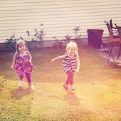 Little Girls running in grass - instagram effect
