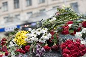 foto of barricade  - Flowers on the barricades of Kiev in place of death during a riot in February 2014 during the political crisis in Ukraine - JPG