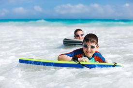 foto of boogie board  - Mother and son surfing on boogie boards - JPG