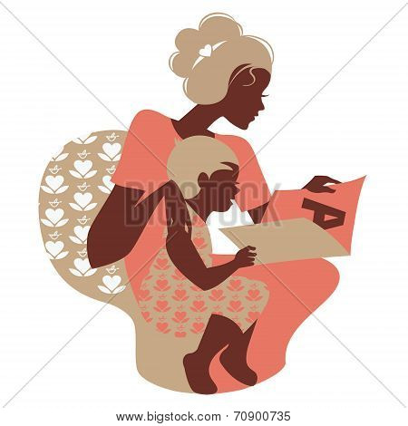 Beautiful silhouette  of mother and baby reading book