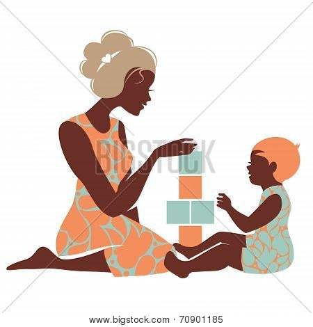 Beautiful silhouette of mother and baby playing with toys