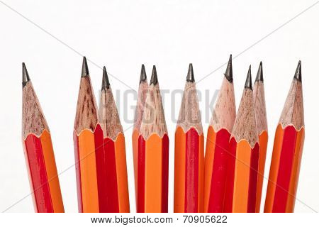 Assorted graphite pencils stacked vertically with white background
