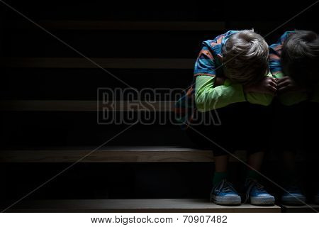 Boy On A Stairway At Night