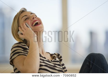 Female Laughing On Cell Phone