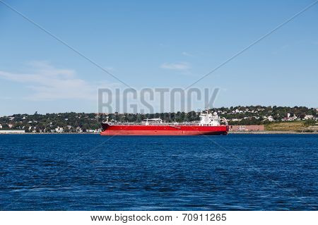 Empty Red Freighter On Blue Water