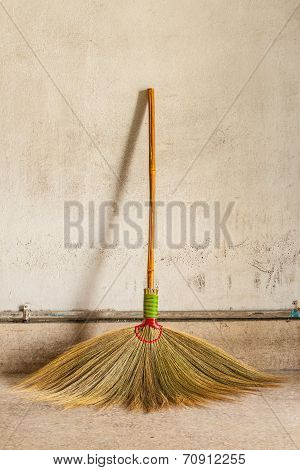 Broom Leaning On The Old Gray Wall
