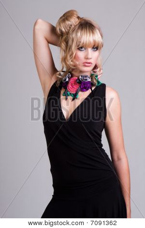 Young Woman In Black Dress And Flower Choker. Isolated