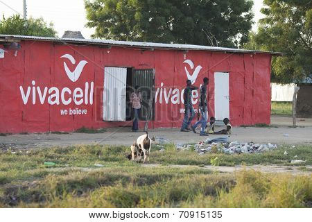 BOR, SOUTH SUDAN-OCTOBER 31 2013: Unidentified teens and children mill about a store operating out of a shack.