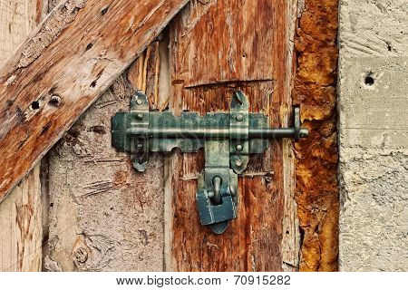 Latch With Padlock On A Old Door