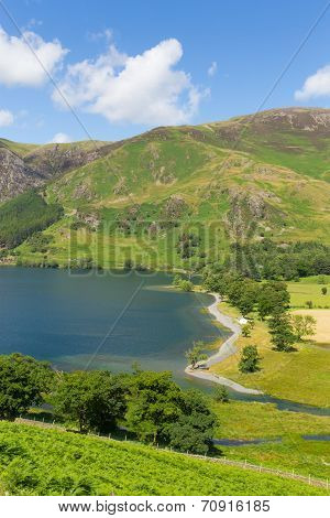 Buttermere Lake District Cumbria England uk on a beautiful sunny summer day surrounded by fells