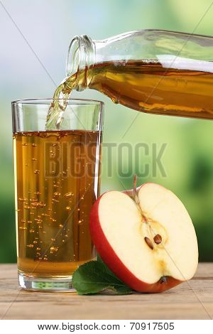 Apple Juice Pouring From Apples Into A Glass