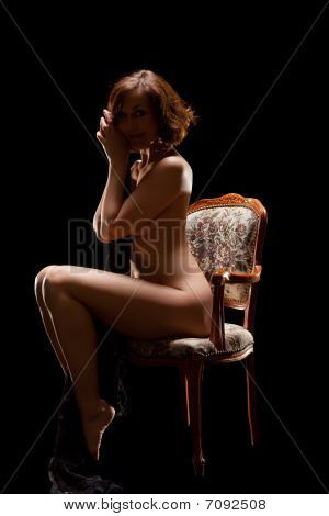 Naked Woman Sitting On Old Chair